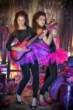 Two beautiful young girls  with electric guitar. Royalty Free Stock Image