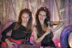 Two beautiful young girls  with electric guitar. Royalty Free Stock Photo