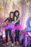 Two beautiful young girls  with electric guitar. Stock Photos