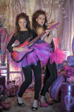 Two beautiful young girls  with electric guitar. Stock Photography