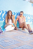 Two beautiful young girls on the floor of an empty pool Royalty Free Stock Image
