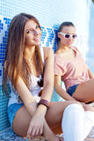 Two beautiful young girls on the floor of an empty pool Stock Photography