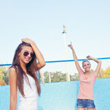 Two beautiful young girls on the floor of an empty pool Stock Photos