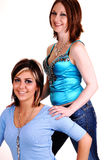Two beautiful young girls in a portrait. Royalty Free Stock Image