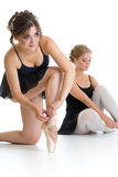 Two beautiful young girls preparing for dance training together Royalty Free Stock Image