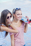 Two beautiful young girls in sunglasses Royalty Free Stock Photography