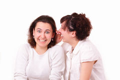 Two beautiful young girls talk Stock Images