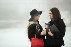 Two beautiful young girls in warm clothes royalty free stock images