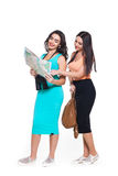 Two beautiful young girls on a white background going travel Royalty Free Stock Photo
