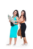 Two beautiful young girls on a white background going travel Stock Images