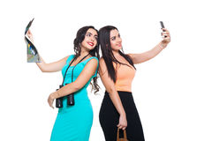 Two beautiful young girls on a white background going travel Royalty Free Stock Photos