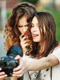 Two beautiful young happy girls make self-photo Royalty Free Stock Photo