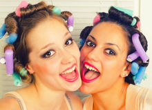 Two beautiful young housewives having fun Royalty Free Stock Photos
