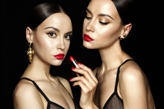 Two beautiful young ladies with red lipstick Stock Photos