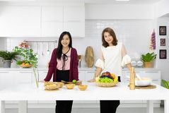 Two beautiful young and middle age Asian woman working together royalty free stock image