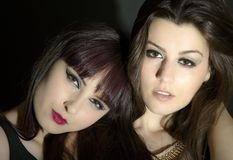 Two beautiful young sensual glamour women standing together over Stock Photography