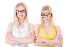 Two beautiful young serious women Royalty Free Stock Images