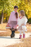 Two beautiful, young sister are on the road Royalty Free Stock Photography