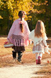 Two beautiful, young sister are on the road Royalty Free Stock Images