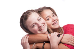 Two beautiful young teenage girls. Photo of a tow nice looking young teenagers posing isolated on a white background Stock Photos