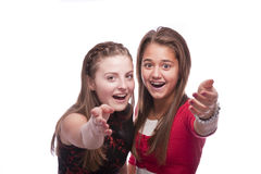 Two beautiful young teenage girls. Photo of a two nice looking young teenagers posing isolated on a white background Stock Photography