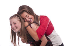 Two beautiful young teenage girls. Photo of a two nice looking young teenagers posing isolated on a white background Royalty Free Stock Photo