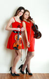 Two woman play violin. Two beautiful young violinist women ful leight Stock Photos