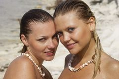 Two beautiful young woman. Two beautiful young women wet Stock Images