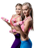 Two beautiful young woman doing fitness exercise Royalty Free Stock Photography