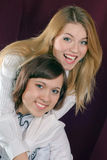 Two beautiful young woman friends smiling, hugging Royalty Free Stock Photography