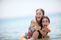 Two beautiful young woman having great time and lots of fun in t royalty free stock photo