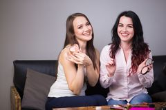 Two young womans reviewing beauty products on video blog at home. Two Beautiful young womans reviewing beauty products on video blog at home Stock Image