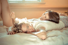 Two beautiful young women in bed Pajamas party stock photos