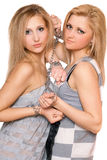 Two beautiful young women bound a chain Royalty Free Stock Photos