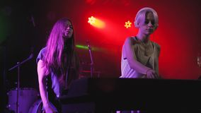 Two beautiful young women DJ play the music on the mixing console in the nightclub. In Odessa stock video footage