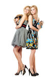 Two beautiful young women with dogs Royalty Free Stock Photography