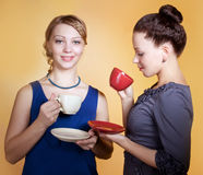 Two beautiful young women drinking coffee  or tea Stock Photography