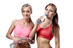 Women drinking water after fitness exercise Royalty Free Stock Photo