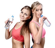 Women drinking water after fitness exercise Royalty Free Stock Photography