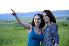 Two beautiful young women in a field Stock Photo