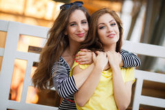 Two beautiful young women having fun in the city Royalty Free Stock Image