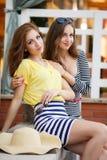 Two beautiful young women having fun in the city Royalty Free Stock Photos