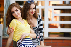 Two beautiful young women having fun in the city Stock Images