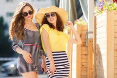 Two beautiful young women having fun in the city Royalty Free Stock Photo