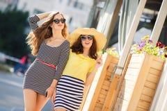 Two beautiful young women having fun in the city Stock Photo