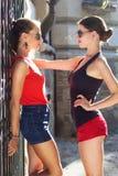 Two beautiful young women having fun in the city Stock Photography