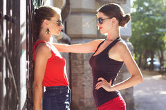 Two beautiful young women having fun in the city Royalty Free Stock Photography