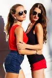 Two beautiful young women having fun in the city Stock Photos