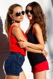 Two beautiful young women having fun in the city Stock Image