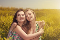Two beautiful young women having fun in the nature Royalty Free Stock Photography